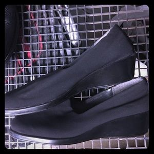 Black fabric wedge shoes by Aerosoles